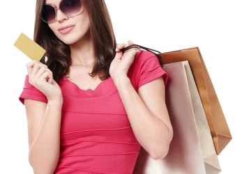 Smiling woman holding shopping bags with a credit card