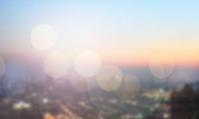 blurred sunrise over city background