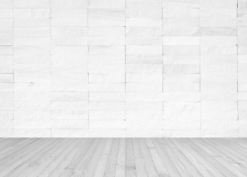 Room with white brick wall and wood floor background