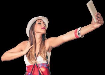 Pretty female tourist takes travel selfie.
