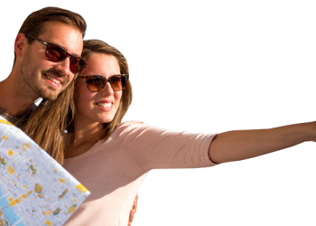 Happy tourist sightseeing with map
