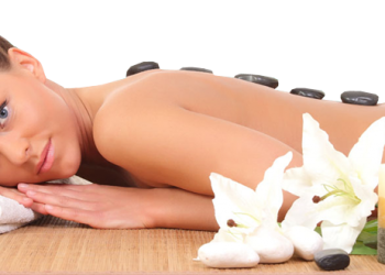 Beautiful Young Woman Enjoying Stone Massage