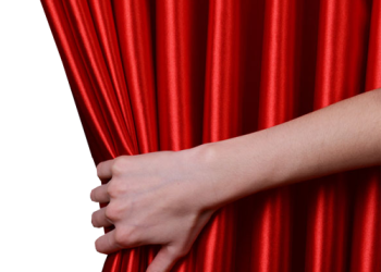 Woman hand pulling red velvet luxury curtain