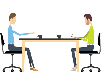 Two young businessman interacting at meeting in office table