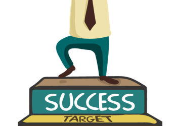 Business man standing on stairs to success