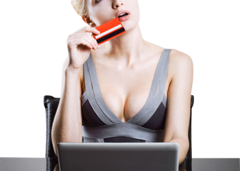 Beautiful girl online shopping with credit card and laptop