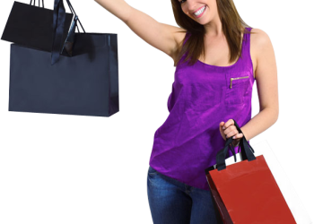 Happy shopping woman smiling holding shopping bags