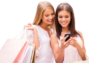 Two happy shopping woman looking at phone