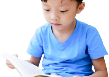 Little Chinese boy reading